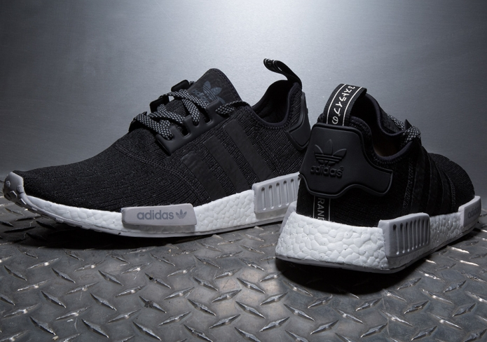 size 40 2f203 beee6 adidas NMD R1 Core Black Champs Exclusive - KicksOnFire.com