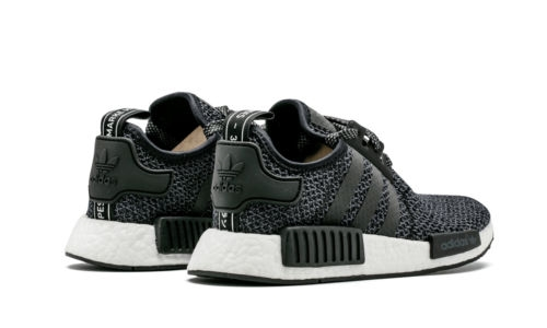 the latest cf7a5 1a483 adidas NMD R1 Black White Champs Exclusive - KicksOnFire.com